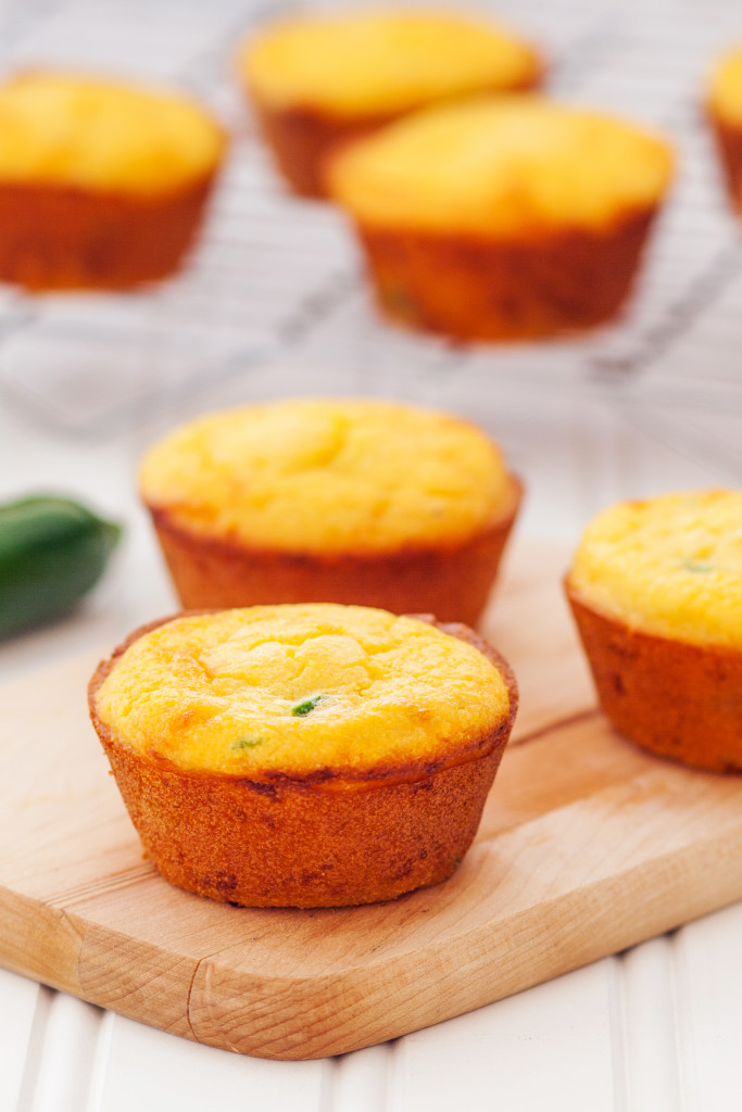 Jalapeño cheddar cornbread muffins. Crackly exterior, ultra-moist interior, and a punch of cheesy and jalapeño-y flavor!