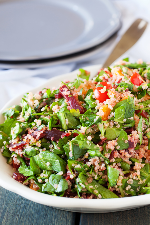 A bed of quinoa and spinach topped with a confetti of beets, mandarins, and tomatoes, this quinoa confetti salad is full of nutrients, vitamins, and fiber to make your meal that much healthier.