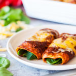 Spinach and cheese enchiladas are a healthier twist on a Mexican favorite. Spinach and cheese filling wrapped in a corn tortilla and doused with an authentic red enchilada sauce.