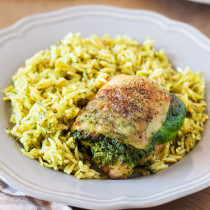 Entrée and side are ready at the same time with this Creamy Spinach Stuffed Chicken with Orzo. Chicken thighs are stuffed with a mixture of spinach and cheese then cooked together with orzo for an easy one-pan dinner.