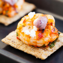 Grilled Mediterranean shrimp atop a crispy TRISCUIT cracker, sprinkled with tangy feta and dolloped with Kalamata olive aioli make these Mediterranean Shrimp Bites the perfect off-the-grill summer appetizer.