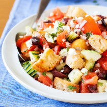 For a hefty side or a light main dish, this Panzanella is fresh and flavorful to accommodate even the pickiest eaters. Made from pre-toasted baguette cubes to prevent water-log, the cubes become softened yet maintain some chew in the fresh tomato juice-based vinaigrette.