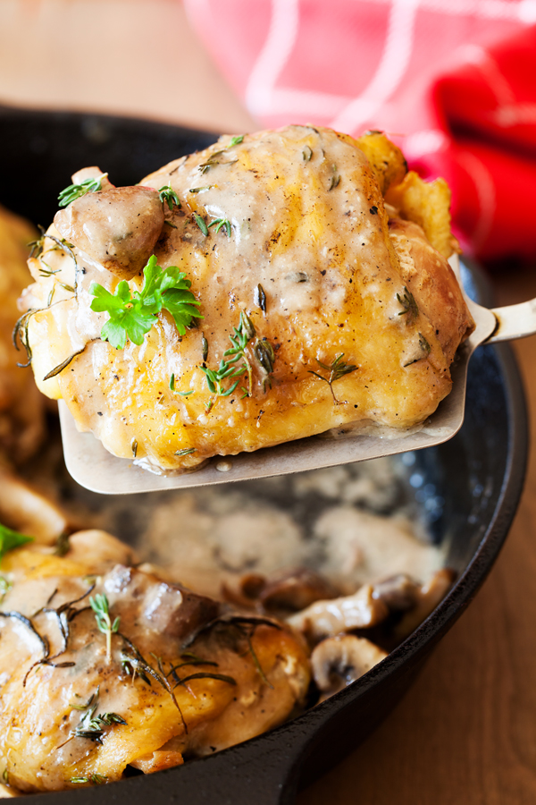 Not just any ol' chicken recipe, this Three Herb Chicken with Mushroom Gravy features juicy chicken thighs cooked to perfection with fresh herbs and smothered in a thick and gravy-like white wine mushroom sauce.