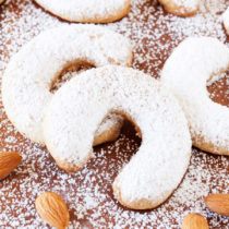 An almond-flavored shortbread cookie dusted with powdered sugar, Dorie Greenspan's Almond Crescents are perfect for this holiday cookie season!