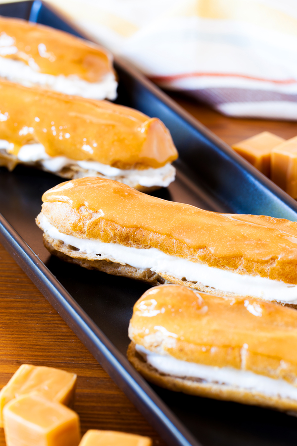 These Pumpkin Pie Spice Éclairs are made from a pumpkin pie spiced pate a choux, are filled with pumpkin pie spice whipped cream, and topped with a delicious caramel glaze that will sure to impress this holiday season.