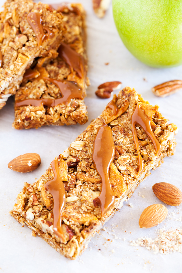 Full of crunchy pecans, chewy apples, and a caramel ribbon, these Caramel Apple Pie Snack Bars are the next best thing to an apple pie without the fuss of the crust.
