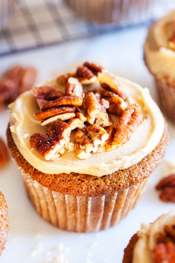 ... thick brown sugar frosting, and sprinkled with crunchy candied pecans
