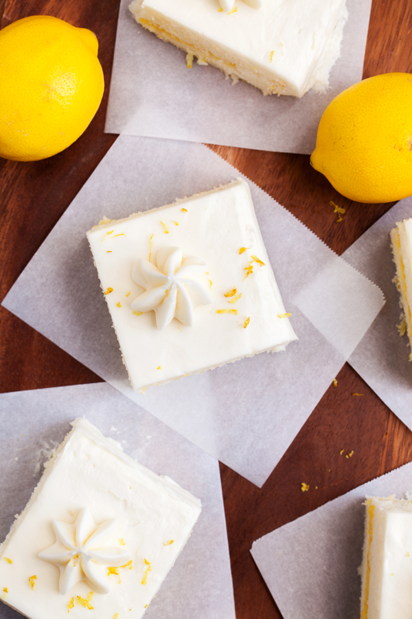 "Two layers of soft white cake, lemon curd filling, and cream cheese frosting make this Lemon Snack Cake the perfect ""light"" and bright dessert."