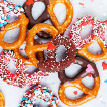 Fun, festive, and easy, these Valentine's Day Dipped Pretzels will make everyone feel special!