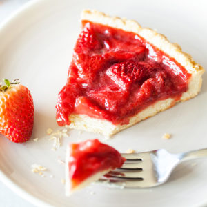 Bursting with strawberry flavor, this Strawberry Tart is loaded with fresh strawberries floating atop a melt-in-your-mouth pate sucrée crust.