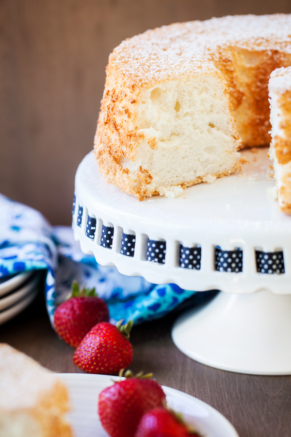 Light and airy Angel Food Cake, delicious with powdered sugar, strawberries or whipped cream!
